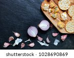 onions and garlic with blue... | Shutterstock . vector #1028690869