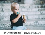 little child boy eating ice... | Shutterstock . vector #1028693107