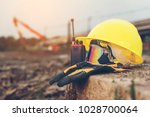 yellow helmets  gloves  radio... | Shutterstock . vector #1028700064