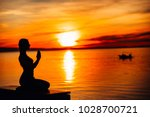 carefree calm woman meditating... | Shutterstock . vector #1028700721