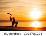 carefree woman meditating in... | Shutterstock . vector #1028701225
