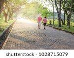 people jogging and walking in... | Shutterstock . vector #1028715079