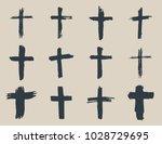 grunge hand drawn cross symbols ... | Shutterstock . vector #1028729695