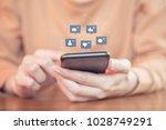 woman hands using mobile... | Shutterstock . vector #1028749291