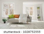 white room with sofa and winter ... | Shutterstock . vector #1028752555