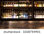 blur bottle of alcohol drink at ... | Shutterstock . vector #1028754901