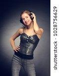 young cheerful girl listening... | Shutterstock . vector #1028756629