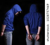 young arrested criminal in... | Shutterstock . vector #1028757469