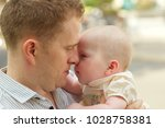father kissing his adorable... | Shutterstock . vector #1028758381