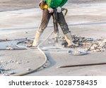 worker of road construction... | Shutterstock . vector #1028758435