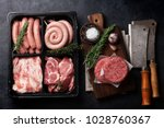 raw meat  cutlet and sausages.... | Shutterstock . vector #1028760367