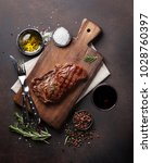 grilled ribeye beef steak with... | Shutterstock . vector #1028760397