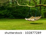 Swing Bench In Lush Garden....