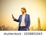 western businessman using a... | Shutterstock . vector #1028801065