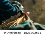 metal polishing with a hand... | Shutterstock . vector #1028802511