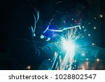 welder in mask welding metal... | Shutterstock . vector #1028802547