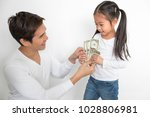 closed up of dad giving pocket... | Shutterstock . vector #1028806981