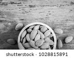 almonds in brown bowl on... | Shutterstock . vector #1028815891