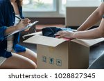 young couple packing and... | Shutterstock . vector #1028827345