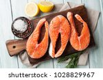 raw salmon fish fillet with... | Shutterstock . vector #1028829967