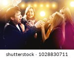 group of happy friends are... | Shutterstock . vector #1028830711
