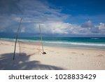playground on the empty beach... | Shutterstock . vector #1028833429