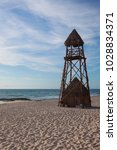 the lifeguard tower on the... | Shutterstock . vector #1028834371