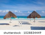 on the empty beach in playa del ... | Shutterstock . vector #1028834449
