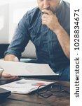 man analyzes the sales report... | Shutterstock . vector #1028834671