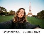woman tourist at eiffel tower... | Shutterstock . vector #1028835025