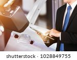 business owner use tablet with... | Shutterstock . vector #1028849755