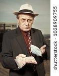 older dealer of narcotics...   Shutterstock . vector #1028909755