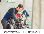 diver preparing to dive into... | Shutterstock . vector #1028910271