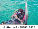 happy diver returns to the ship ... | Shutterstock . vector #1028912599