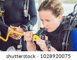 diver prepares his equipment... | Shutterstock . vector #1028920075