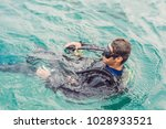 divers on the surface of water... | Shutterstock . vector #1028933521