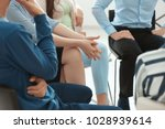 people at group psychotherapy... | Shutterstock . vector #1028939614