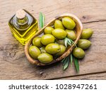 olive berries and bottle of... | Shutterstock . vector #1028947261