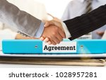 Small photo of businessman shaking hands during meeting with business agreement document. agreement concept.