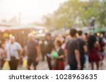 blur of people and environment... | Shutterstock . vector #1028963635
