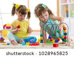 two kids playing with wooden...   Shutterstock . vector #1028965825