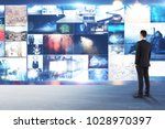 businessman looking at abstract ... | Shutterstock . vector #1028970397