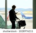 waiting at the airport | Shutterstock . vector #1028976211