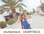 happy smiley girl with retro... | Shutterstock . vector #1028978221