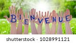 word bienvenue means welcome on ... | Shutterstock . vector #1028991121