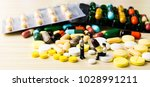 medicine pills or capsules on... | Shutterstock . vector #1028991211