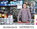 smiling adult man standing near ... | Shutterstock . vector #1029000721