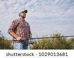 young unshaven man in checkered ... | Shutterstock . vector #1029013681