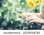 woman is checking phone message | Shutterstock . vector #1029018781