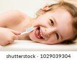 happy little girl lost her... | Shutterstock . vector #1029039304